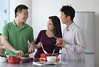 Friends cooking in the kitchen - Asia Images Group