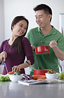 Couple cooking together - Asia Images Group