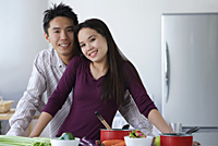 Couple together in the kitchen - Asia Images Group