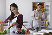 Young couple cooking in the kitchen - Asia Images Group