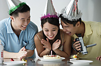 Friends celebrating birthday - Asia Images Group