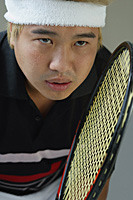 Man playing tennis - Asia Images Group