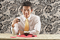 Man having meal at restaurant - Asia Images Group