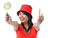 Young woman with lollipop smiling at camera - Asia Images Group