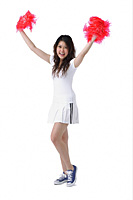 Young woman cheerleading with pom poms - Asia Images Group