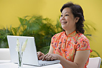 Mature woman at laptop - Asia Images Group