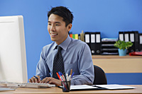 Businessman working at computer - Asia Images Group