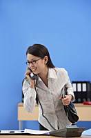 Businesswoman talking on the phone - Asia Images Group