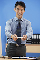 Businessman offering his business card - Asia Images Group