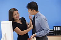 Woman pushing away businessman - Asia Images Group