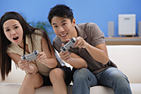 Couple playing video games - Asia Images Group