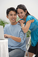 Young couple smiling at camera - Asia Images Group