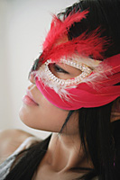Young woman in feather mask - Asia Images Group