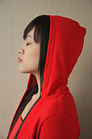 Young woman with eyes closed in profile - Asia Images Group