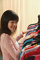 Young woman shopping for clothes - Asia Images Group