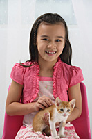 Young girl with kitten on her lap - Asia Images Group