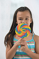 Young girl with big lollipop - Asia Images Group