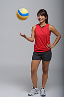 Young woman playing with volleyball - Asia Images Group