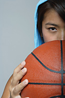 Young woman with basketball looking at camera - Asia Images Group