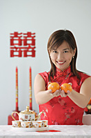 Young woman performing tea ceremony and smiling at camera - Asia Images Group
