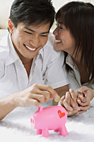 Young couple with piggy bank - Asia Images Group