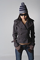 Young woman with sunglasses and winter clothes - Asia Images Group