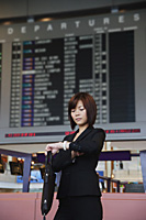 Young woman waiting at the airport - Asia Images Group