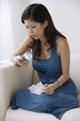 Young woman using mobile phone - Asia Images Group