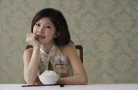 Young woman with bowl of rice - Asia Images Group