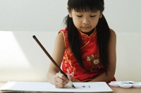 Young girl practicing calligraphy - Asia Images Group
