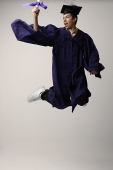 Graduate jumping for joy - Asia Images Group