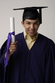 Graduate with diploma - Asia Images Group