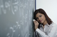 Tired teacher at chalk board - Asia Images Group