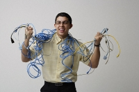 Man with cords and wires around his neck - Asia Images Group