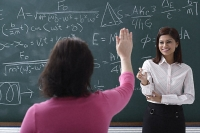 Adult student raising hand for teacher - Asia Images Group