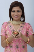 Young woman dressed in traditional Indian clothing (salwar kameez) - Asia Images Group