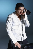 Young man working as DJ - Asia Images Group