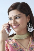 Young Indian woman on mobile phone - Asia Images Group
