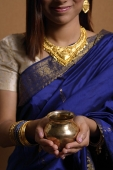 Indian woman holding offering - Asia Images Group