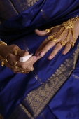Indian woman painting finger nails - Asia Images Group