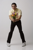 Nerd offering flowers - Asia Images Group