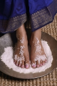 Indian woman with feet in salt scrub - Asia Images Group