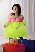 woman with shopping bags - Asia Images Group