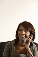 Business woman smiling, talking on the phone - Asia Images Group