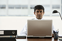 business man working on laptop - Asia Images Group