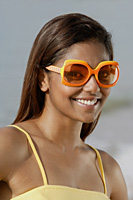 Portrait of woman with sunglasses, smiling - Asia Images Group