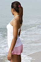 Side view of woman looking at ocean - Asia Images Group