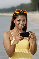 Portrait of woman with mobile phone camera - Asia Images Group