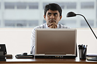 business man, hands propping chin, thinking - Asia Images Group