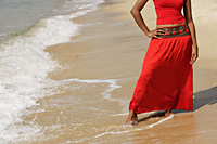 woman standing on beach - Asia Images Group